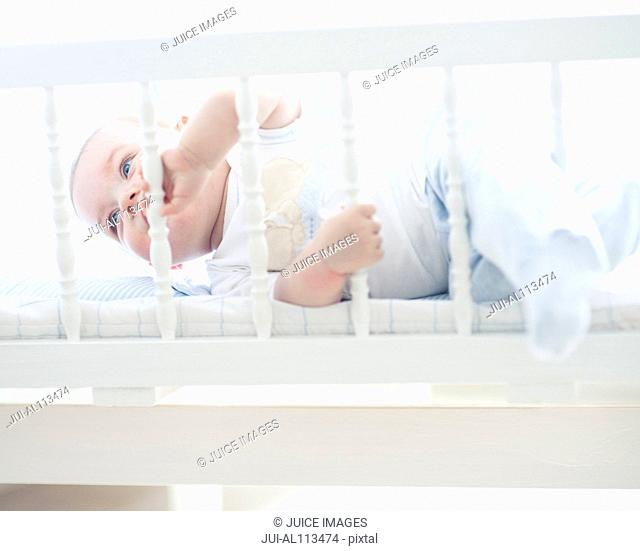 Baby boy in cot