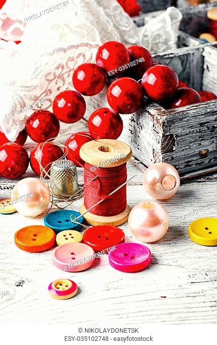 Sewing kit made of lace,buttons,beads and thread with needle