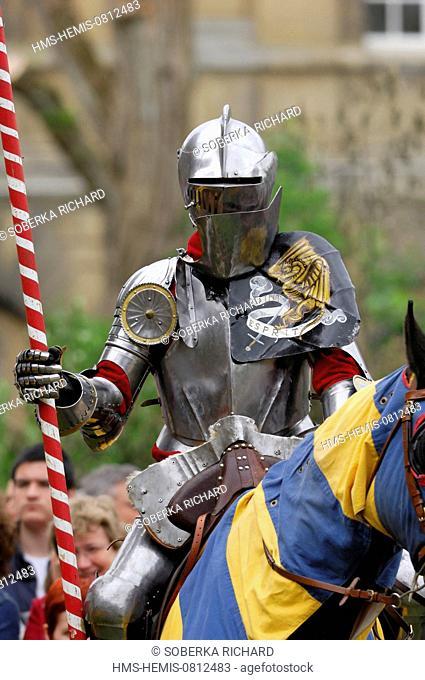 France, Ardennes, Sedan, medieval festival, armored knight on horseback at a jousting