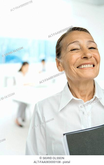 Senior businesswoman, smiling