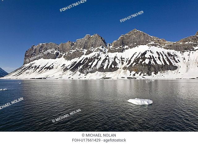A view of the towering cliff and glacier in Hornsund Horn Sound on the southwestern side of Spitsbergen Island in the Svalbard Archipelago, Barents Sea, Norway
