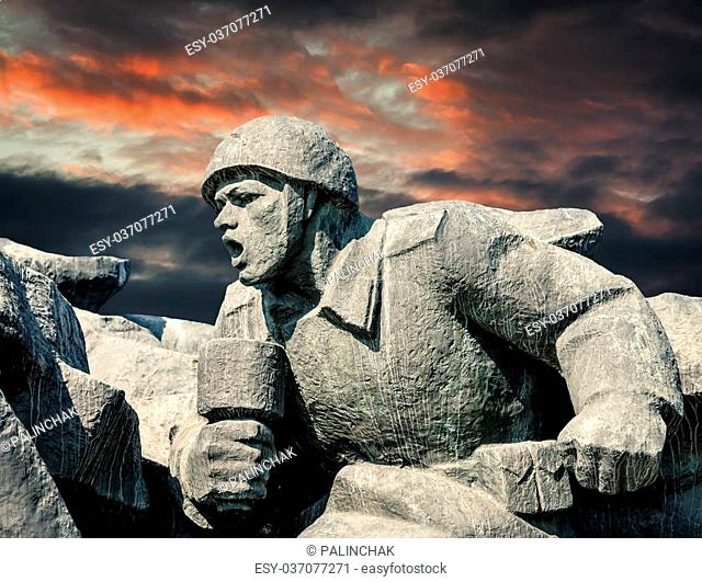 Soviet era WW2 memorial in Kiev Ukraine against dramatic sky background