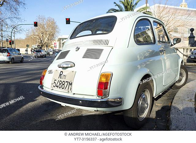 A Classic Fiat 500 with Roma number plates in Rome city street. Lazio, Italy