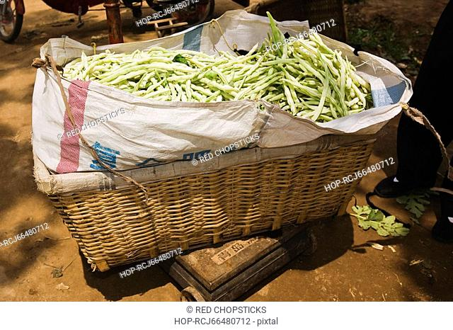Beans in a basket at a market stall, Zhigou, Shandong Province, China