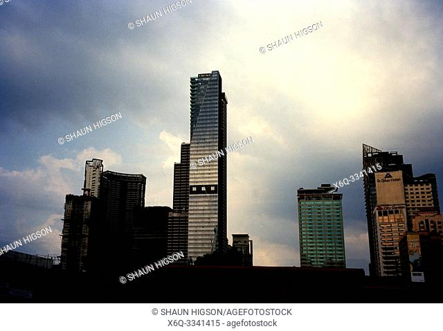 Manila skyline and Trump Tower in Makati in Manila in Luzon Metro Manila in the Philippines in Southeast Asia Far East