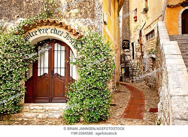 Jasmine covered entryway to shop in ancient town of Eze, Provence France