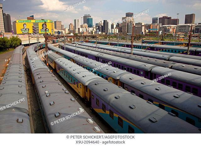 trains and tracks of the central Park Station and the skyline of Johannesburg, Gauteng, South Africa, Africa