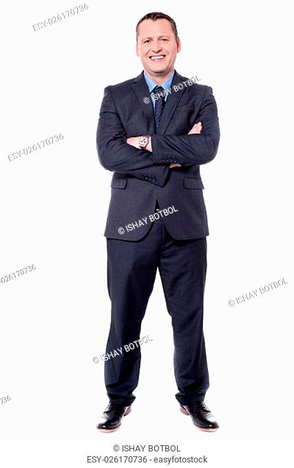 Confident businessman isolated on white with folded arms