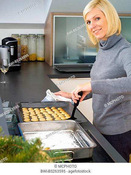 Woman is baking Vanillekipferl