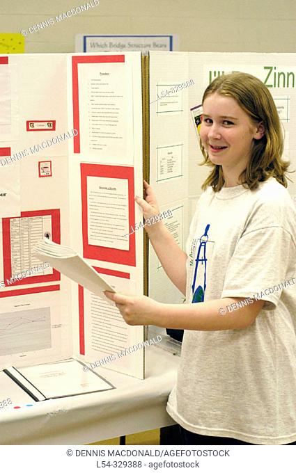 8th grade student displays science project
