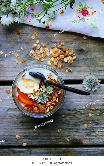 Yoghurt with granola and flowers