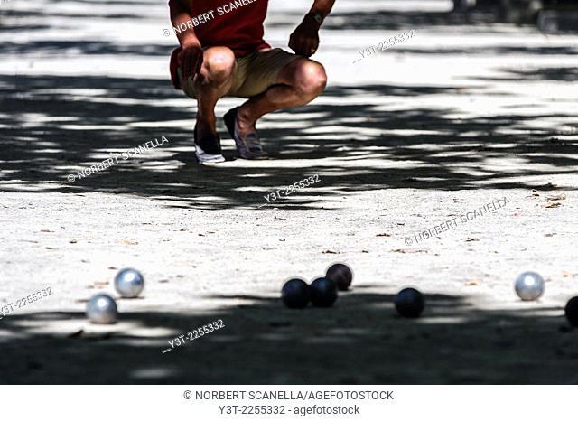 Europe, France, Var, Saint-Tropez. Place des lices. Man Playing petanque