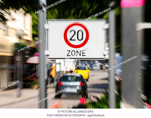05 June 2019, Hessen, Hanau: A car drives through the speed 20 zone on Langstraße. The Gebrüder Grimm City wants to try to slow down speeders and car-posers in...