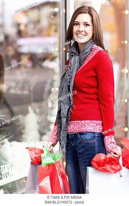 Mixed race woman shopping