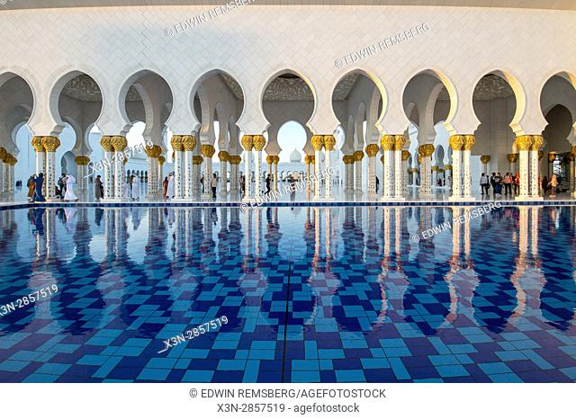 United Arab Emirates - Reflection of arches on water of Sheikh Zayed Mosque in Abu Dhabi