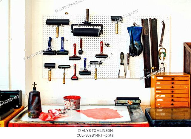 Still life of rollers, ink and equipment in print workshop