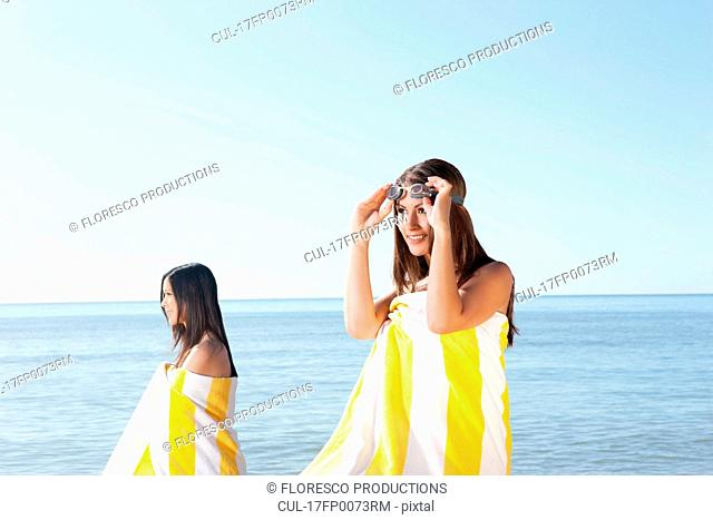 Female bathers looking out to sea