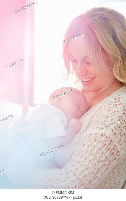 Mother hugging newborn baby boy