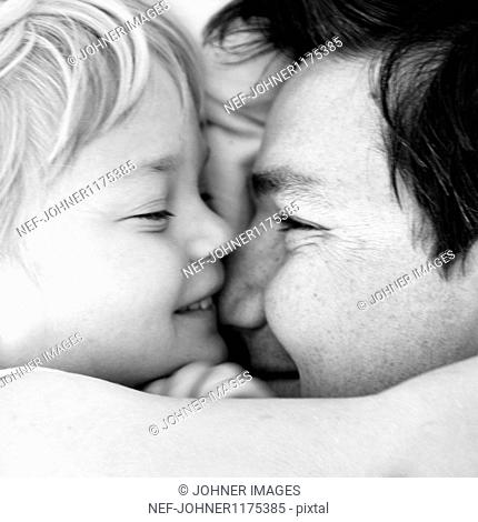 Father with daughter embracing and smiling