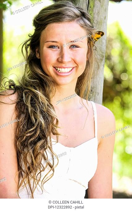 Portrait of a teenage girl with long curly hair; Oregon, United States of America