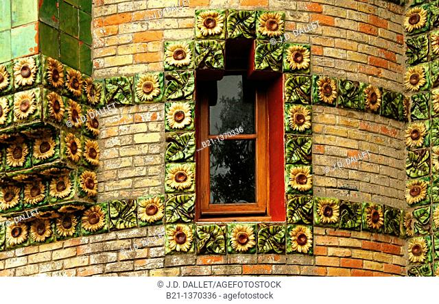 Window detail with sunflowers ceramic tiles at El Capricho by architect Gaudi, Comillas, Cantabria, Spain