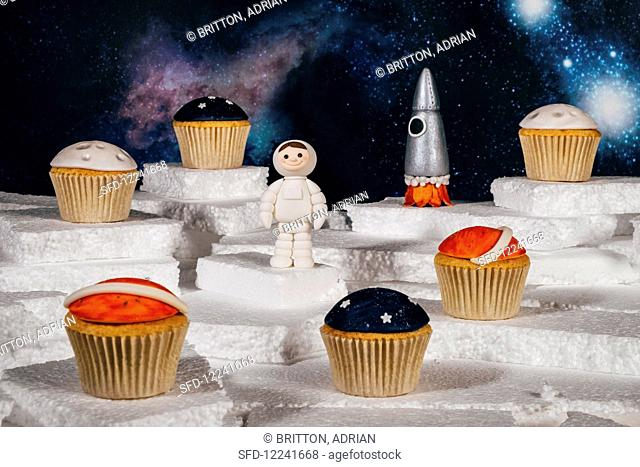 Space themed cupcakes and cake toppers