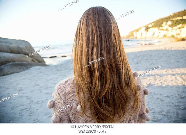 Young Woman Sat On Beach