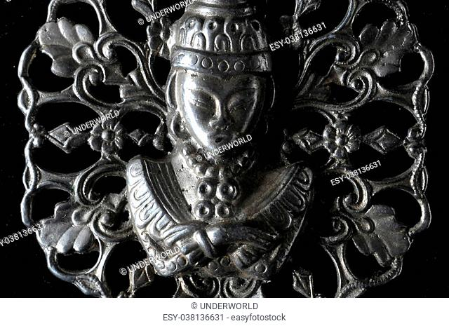 Silver Buddha Pendant Jewel over a Black Background