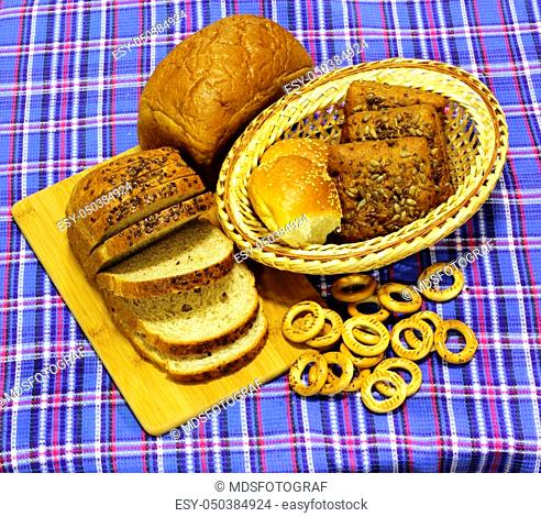 Bread. Wheat bread products are on blue tartan