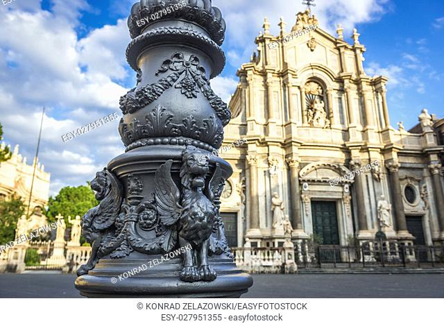 Winged lions on a lantern at Cathedral Square in Catania city, east side of Sicily Island, Italy. Cathedral of Saint Agatha on background