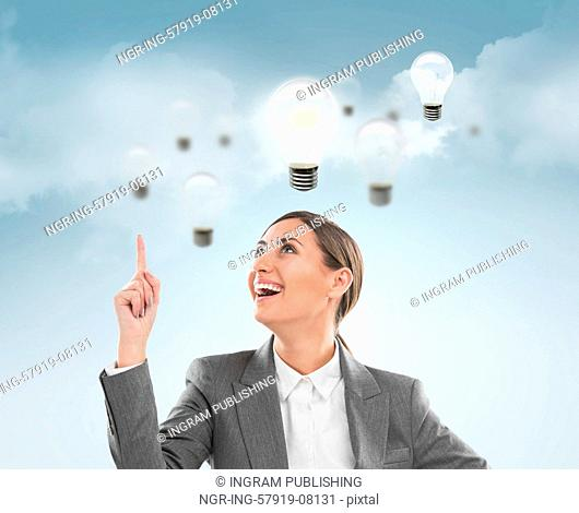 Woman with lamps overhead, idea concept on sky background