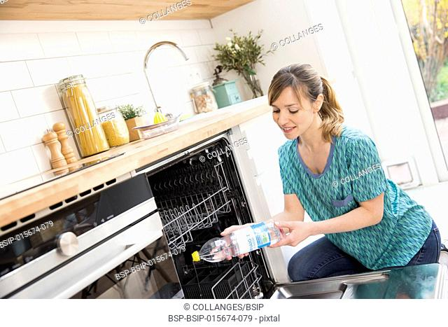 Woman using white vinegar