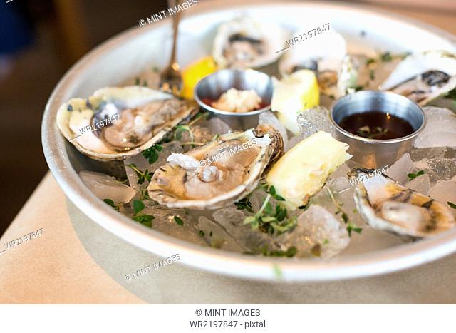 Close up of a plate of fresh oysters