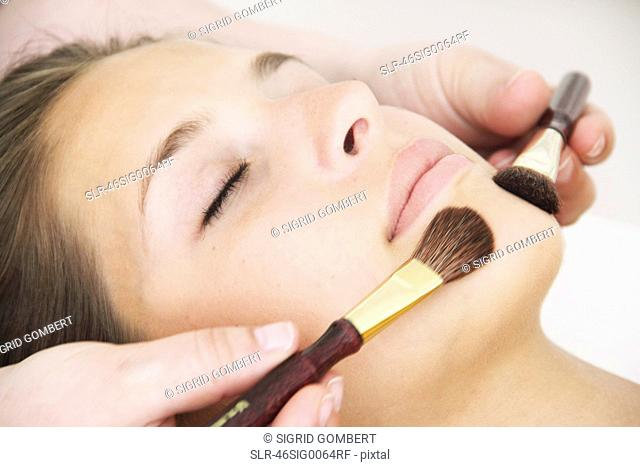 Close up of woman having facial in spa