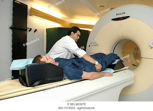 PETSCAN<BR>Photo essay from hospital.<BR>Nuclear medicine unit at the Hôpital Saint Louis in Paris. Positioning the patient in preparation for a PET scan
