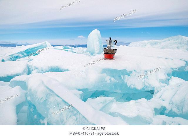 Italian coffe machine Moka on the blocks of ice, Lake Baikal, Irkutsk region, Siberia, Russia