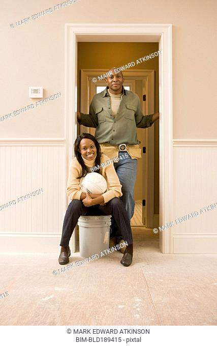 African couple doing home improvement