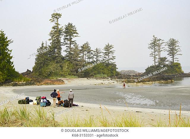 A group of campers on the beach on Flores Island, off the west coast of Vancouver Island, British Columbia, Canada