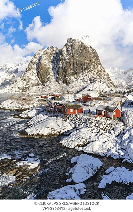Hamnoy village covered in snow, with Festheltinden peak in the background. Moskenes municipality, Nordland county, Northern Norway, Norway