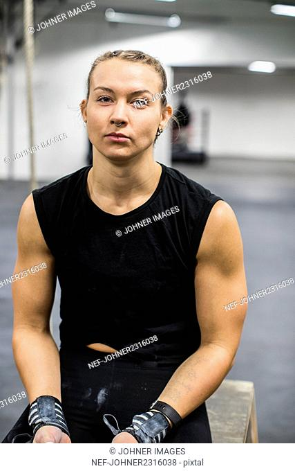 Muscular woman in gym