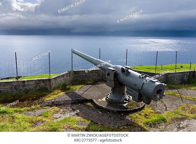 Cannon in the village Nes dating back to the second world war, now a historic monument. The island Eysturoy one of the two large islands of the Faroe Islands in...