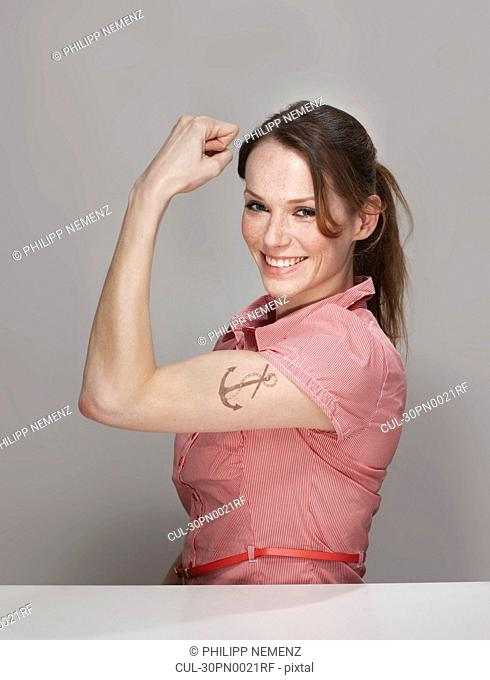 Women with Anchor Tatoo showing Muscle