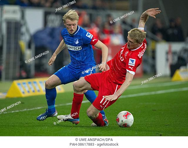 Hoffenheim's Andreas Beck (L) vies for the ball with Duesseldorf's Axel Bellinghausen during the Bundesliga soccer match between 1899 Hoffenheim and Fortuna...