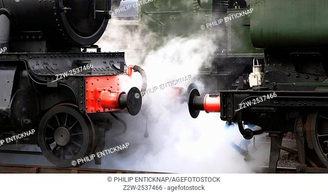 Close up of steam emitting between locomotives at Didcot Railway Centre. A working heritage rail museum Based around the original Great Western Railway Engine...