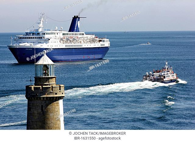Cornet cruise ship at anchor, passenger ferry, off the pier with lighthouse at Castle Cornet, port fortress, entrance to the port of St