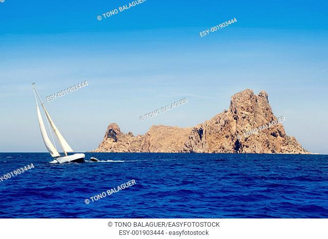 Ibiza sailboat in Es Vedra island at Mediterranean blue sea
