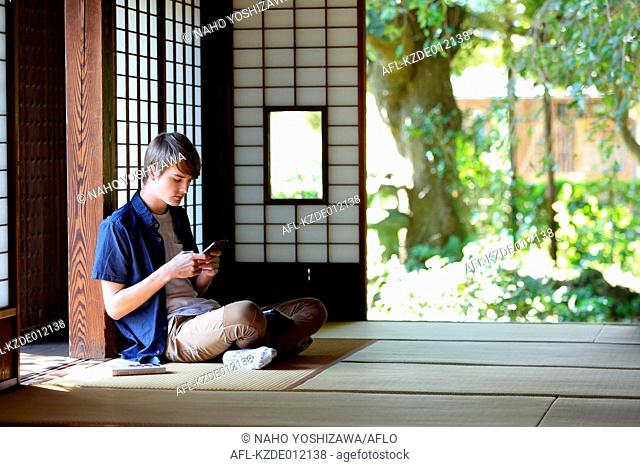 Caucasian man in traditional Japanese house