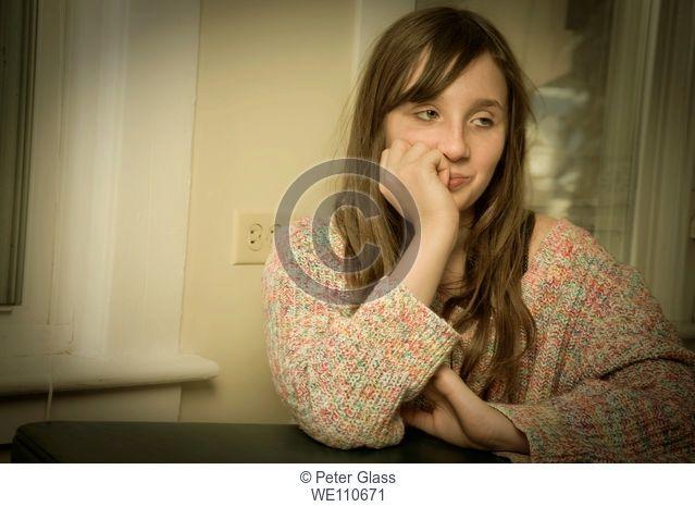 Preteen girl posing