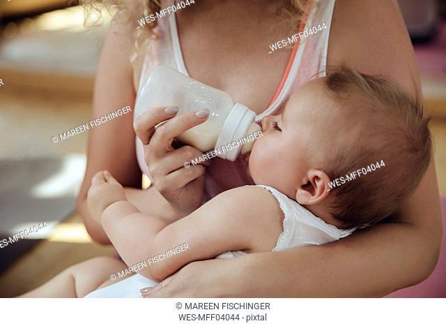 Mother bottle-feeding her baby