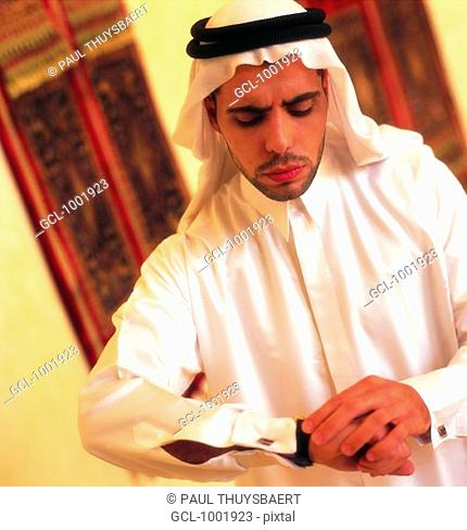 Arab man checking the time